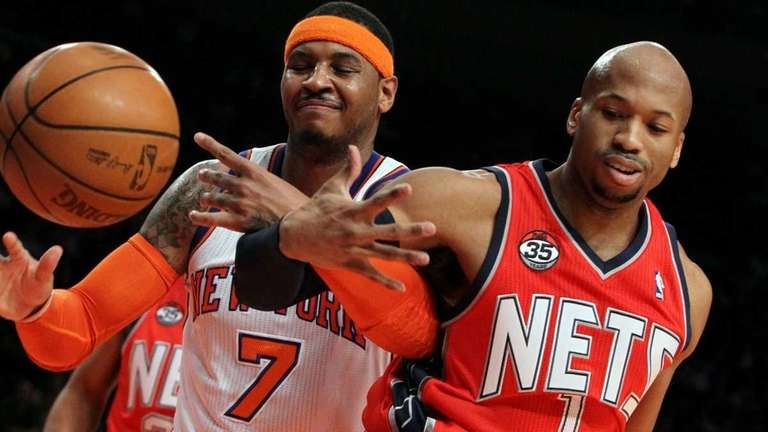 Carmelo Anthony of the New York Knicks battles