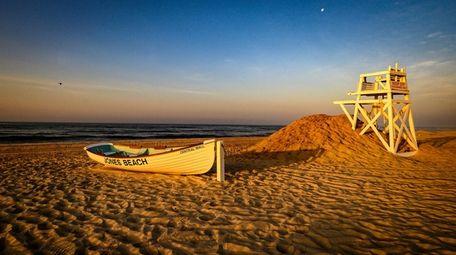 The sun rises over Jones Beach on Saturday.
