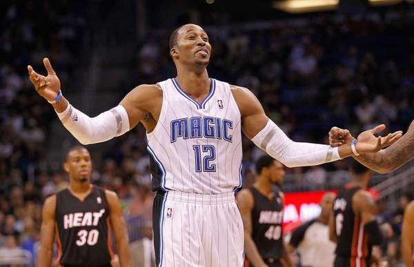 Dwight Howard #12 of the Orlando Magic argues