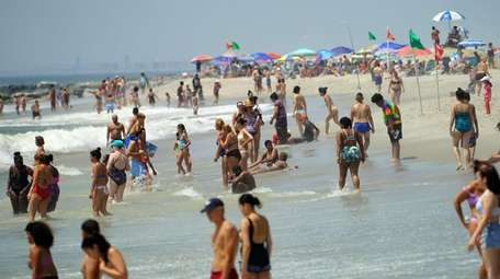 People flock to the ocean at Long Beach
