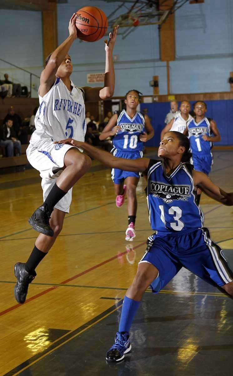 Riverhead's Melodee Riley (5) with the driving jumper
