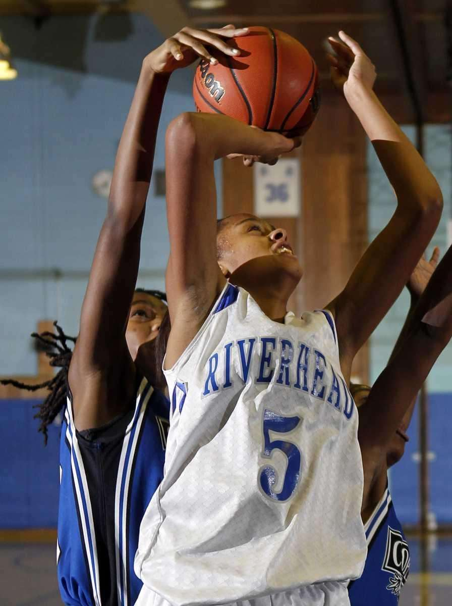 Riverhead's Melodee Riley's (5) jumper under the basket