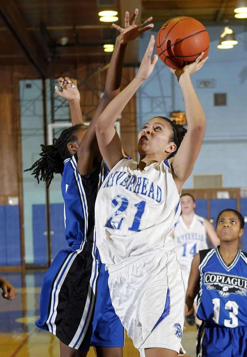 Riverhead's Kaila-Riane Nazario (21) with the jumper in