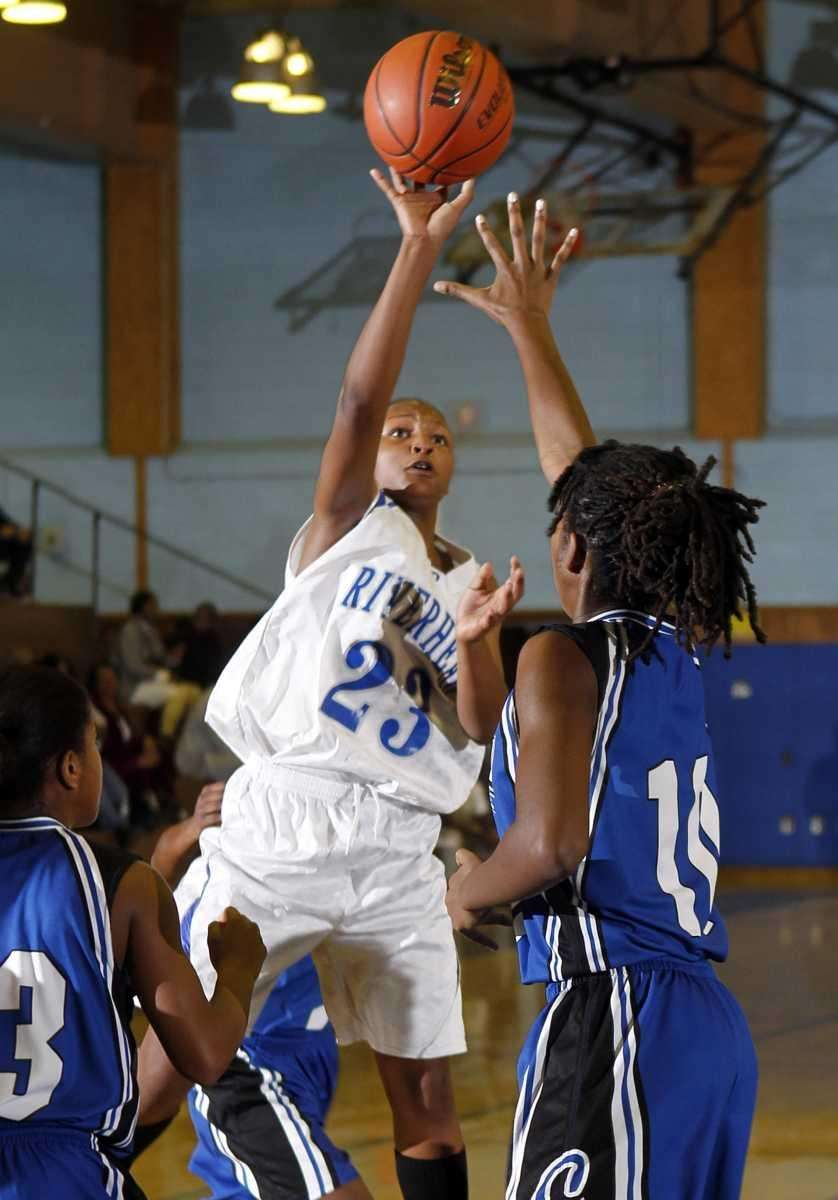 Riverhead's Shanice Allen (23) with the one handed