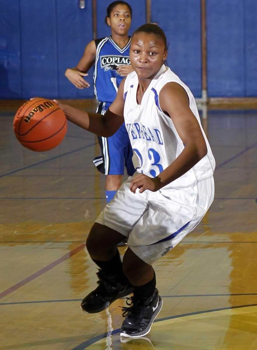 Riverhead's Shanice Allen (23) drives to the hoop