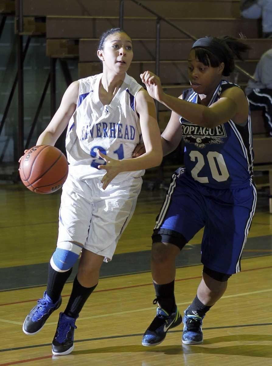 Riverhead's Kaila-Riane Nazario (21) drives the baseline against