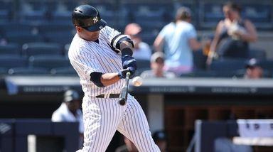 Yankees designated hitter Edwin Encarnacion (30) hits an