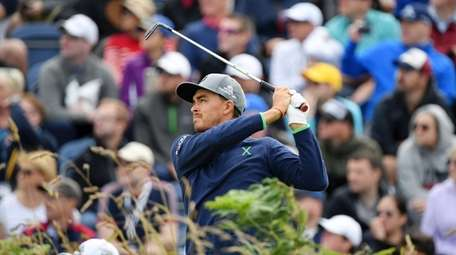 Rickie Fowler of the United States plays a