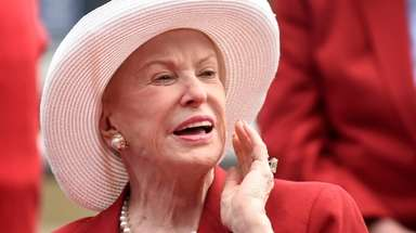 Marylou Whitney talks to reporters after being inducted