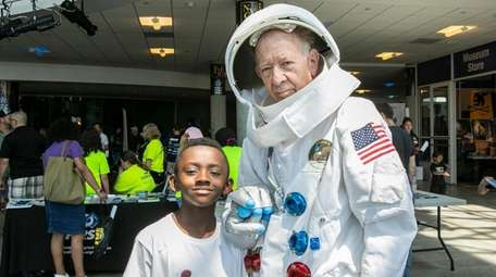 Edward Phillips, 8, of Mastic, with Al Wirth
