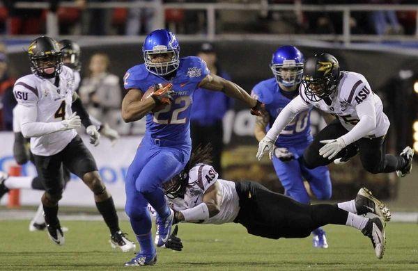 Boise State running back Doug Martin (22) breaks