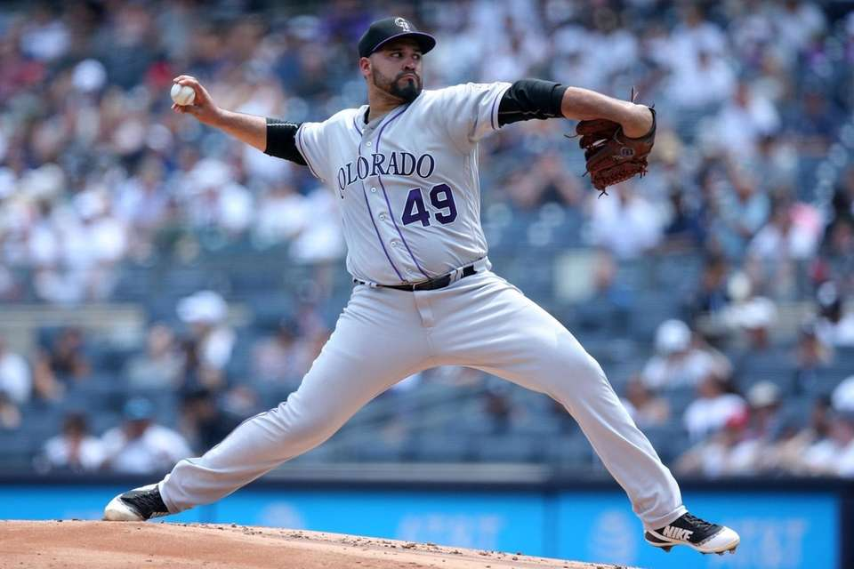 Colorado Rockies starting pitcher Antonio Senzatela (49) pitches