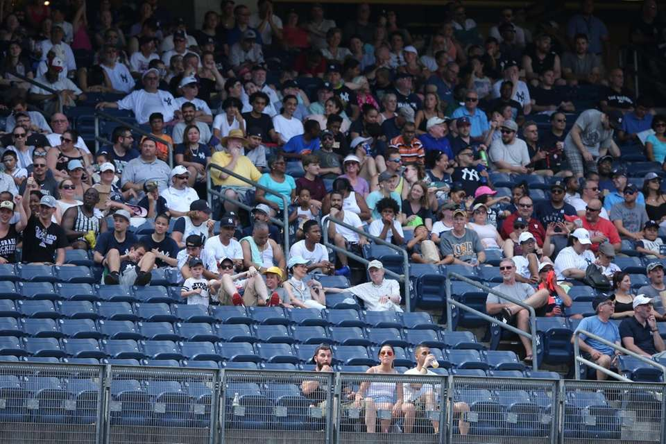 Many fans take shelter from the sun in