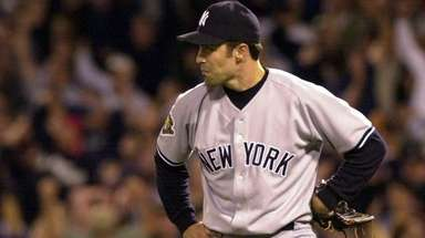 New York Yankees pitcher Mike Mussina reacts after