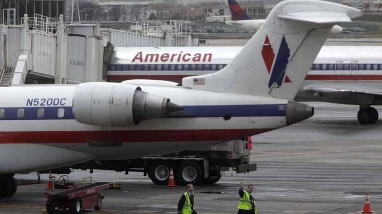 American Airlines' planes are parked at a gate