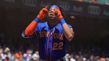 Dominic Smith, whose drop of a fly ball