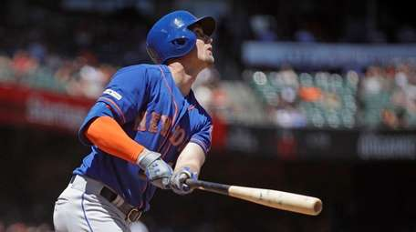 Mets' Jeff McNeil watches his two run home