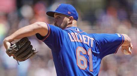 Walker Lockett #61 of the Mets pitches against