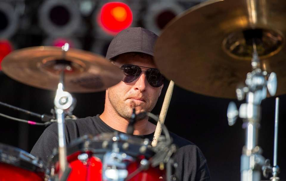 Drummer Nick Tkachyk performs with the band Spafford