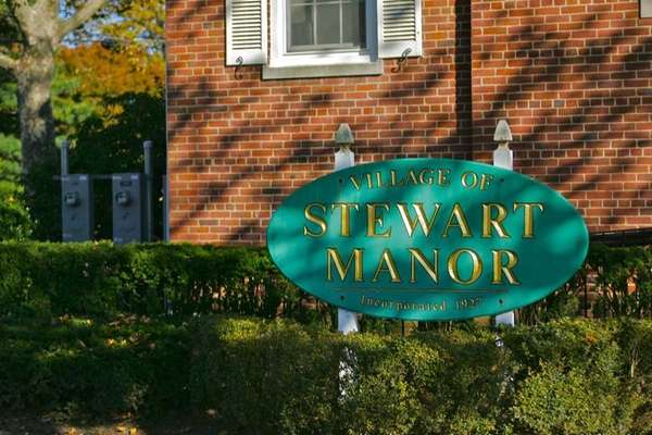The Village of Stewart Manor sign, in front