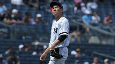 Yankees starting pitcher Masahiro Tanaka (19) reacts during