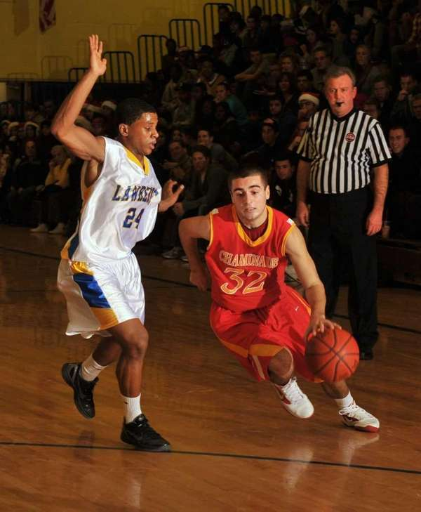 Chaminade's John Gallego drives around Lawrence's Dwayne Daniel