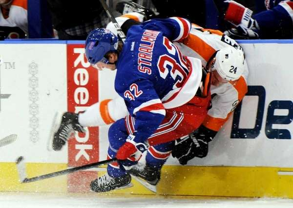 New York Rangers' Anton Stralman checks Philadelphia Flyers'