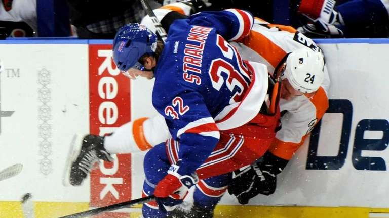 New York Rangers' Anton Stralman checks Philadelphia Flyers'