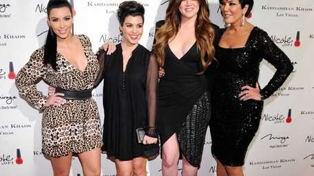 Television personalities Kim Kardashian, Kourtney Kardashian, Khloe Kardashian