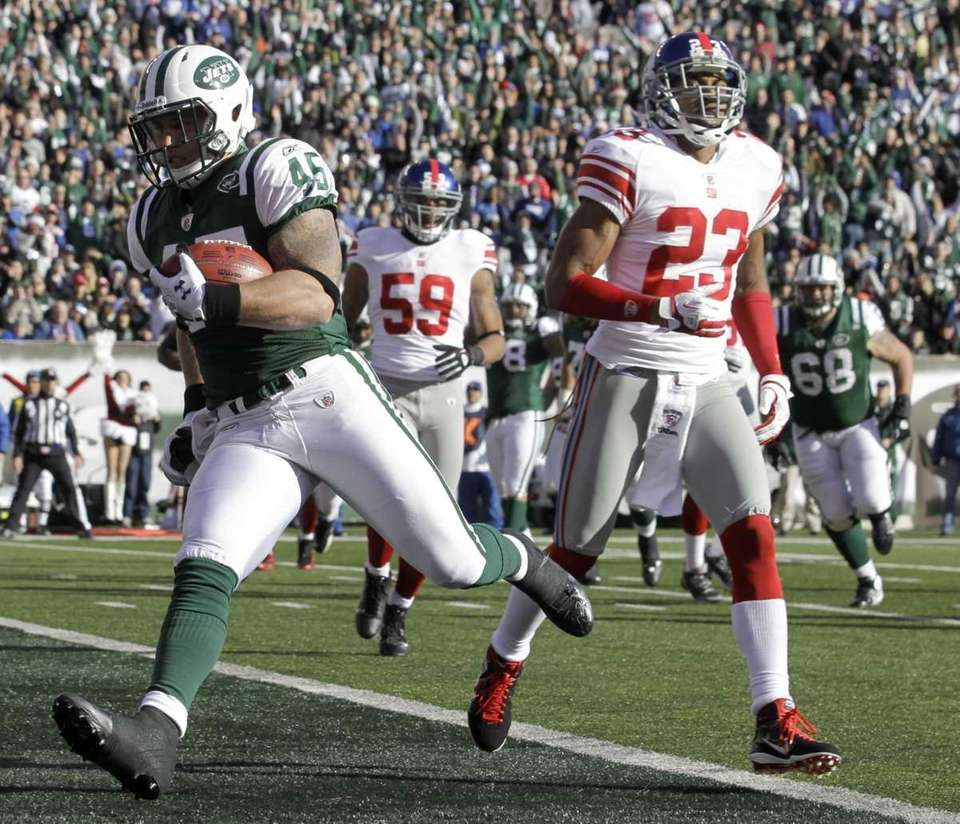 New York Jets' Josh Baker, left, scores a