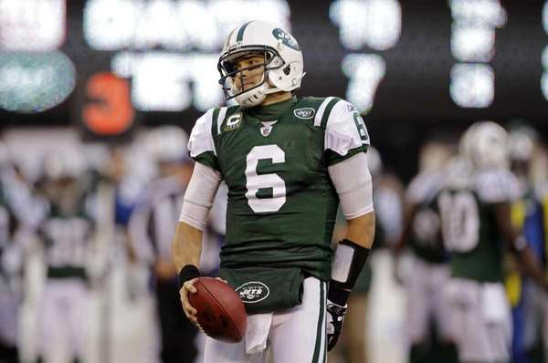 New York Jets quarterback Mark Sanchez reacts during