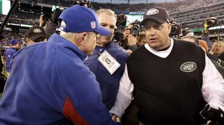 New York Jets head coach Rex Ryan, right,
