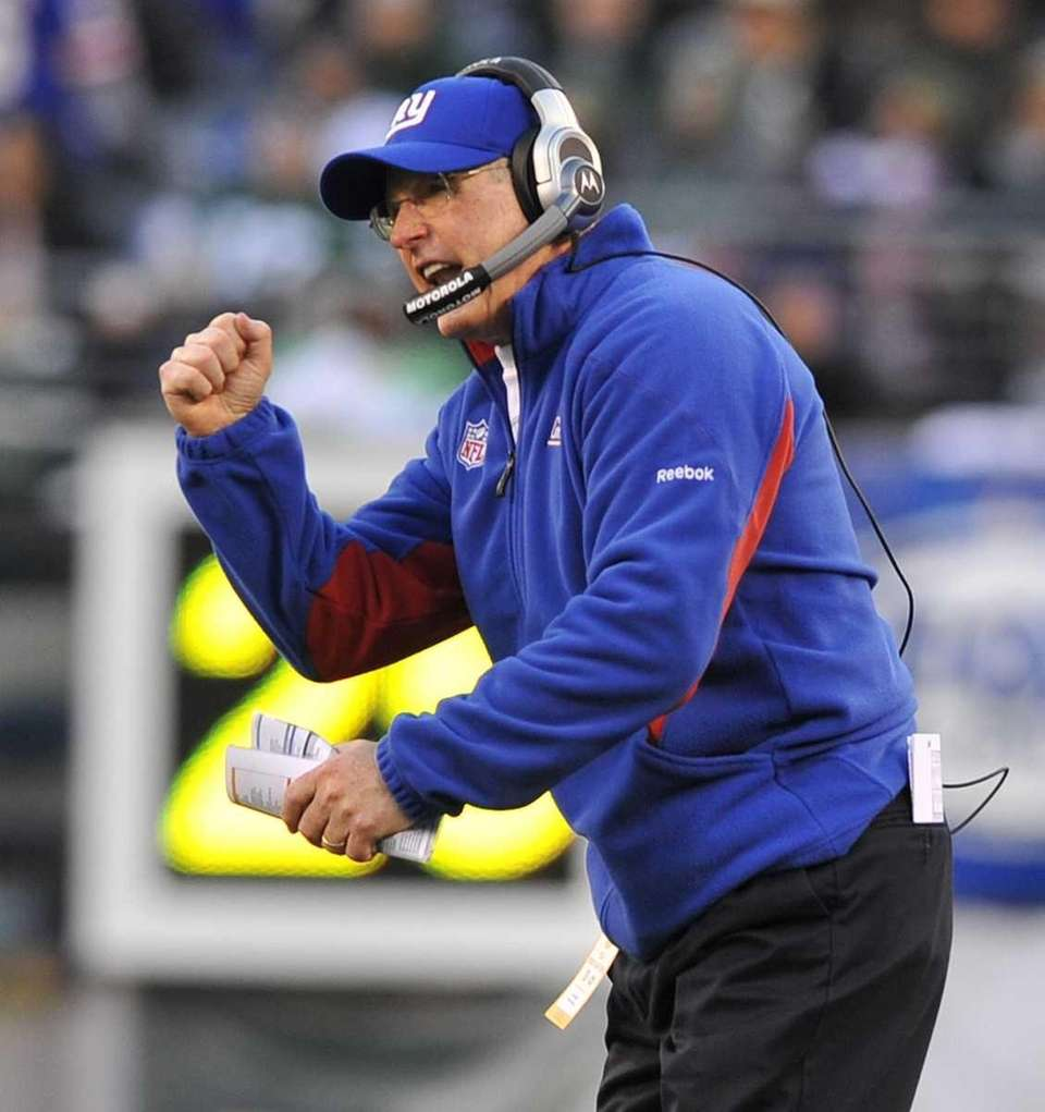 Gians coach Tom Coughlin pumps his fist after