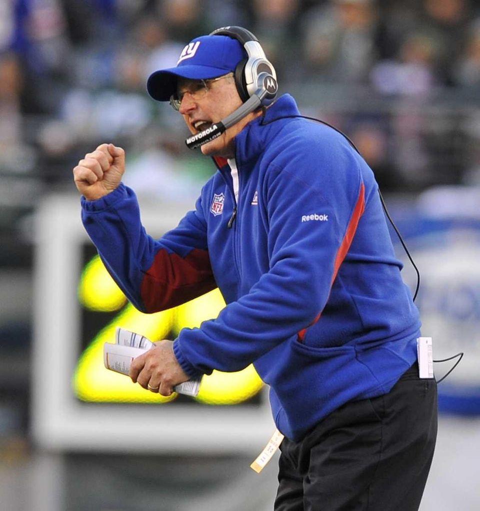 Gians coach Tom Coughlin pumps his fist after