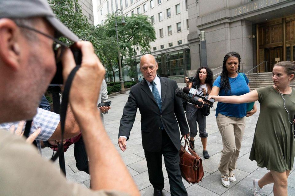 Defense attorney Martin G. Weinberg, center, exits a