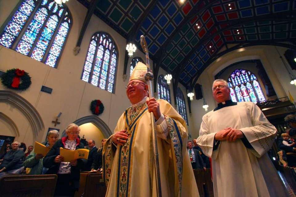 Bishop William Murphy leads the procession as he