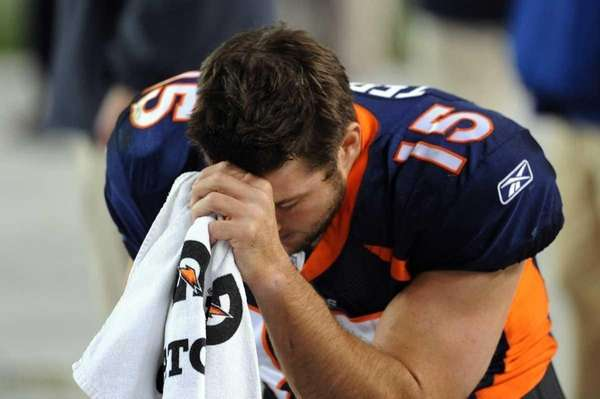 Tim Tebow of the Denver Broncos prays during