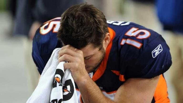 Tim Tebow of the Denver Broncos prays during
