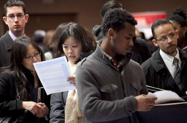 Job seekers wait on line at a career