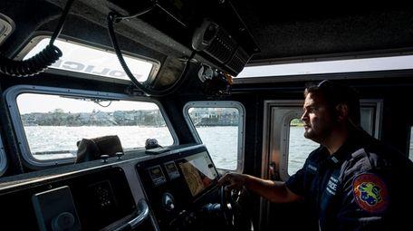 Nassau County Marine Bureau Officer Joseph Stassi keeps