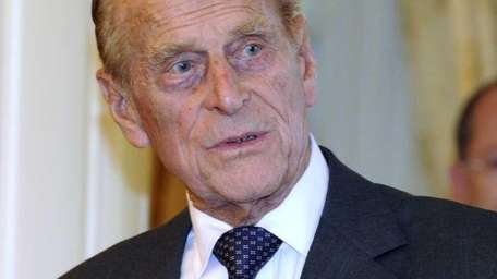 Britain's Prince Philip arrives at Government House in