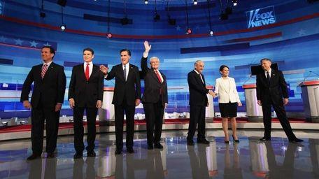 Republican presidential candidates (L-R) former U.S. Senator Rick