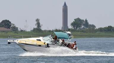 Boaters and jet skiers make their way through
