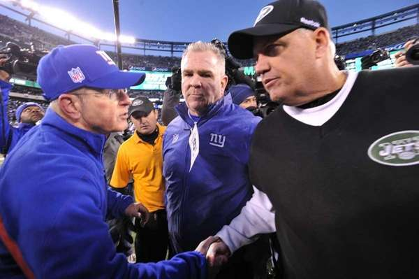 Tom Coughlin and Rex Ryan after the game.