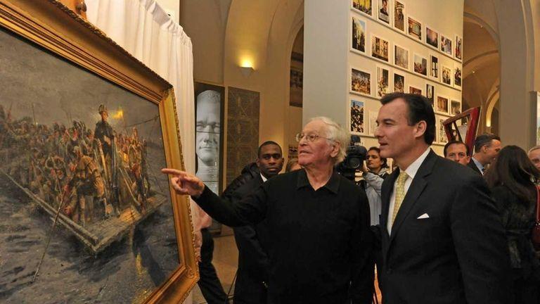 Cove Neck Artist Mort Künstler stands before his