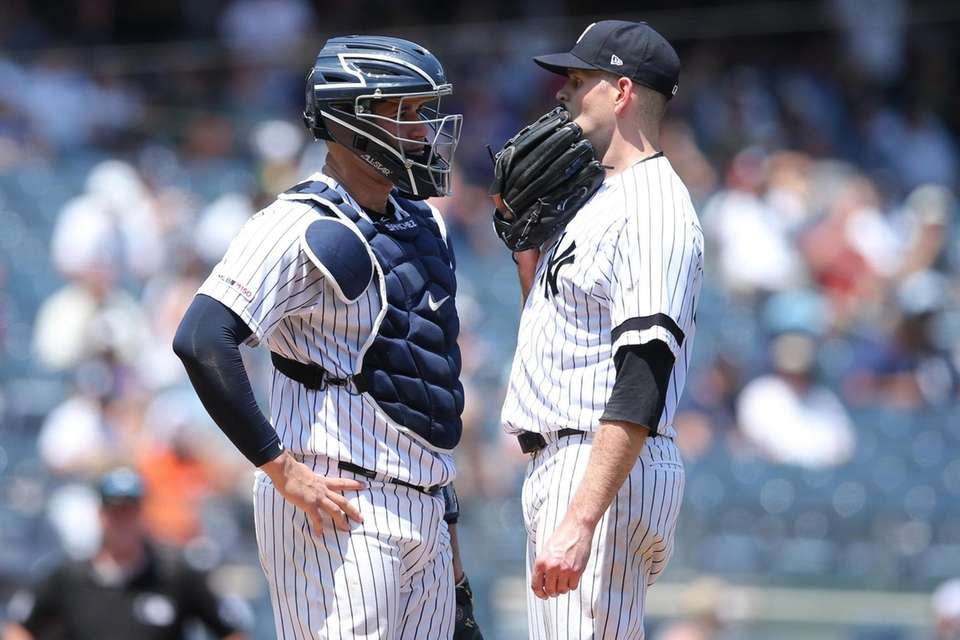 Yankees catcher Gary Sanchez talks to starting pitcher