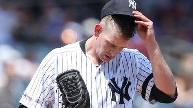 Yankees pitcher James Paxton reacts during the third