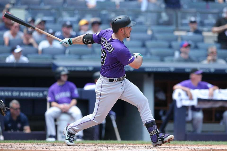 Colorado Rockies third baseman Nolan Arenado (28) hits