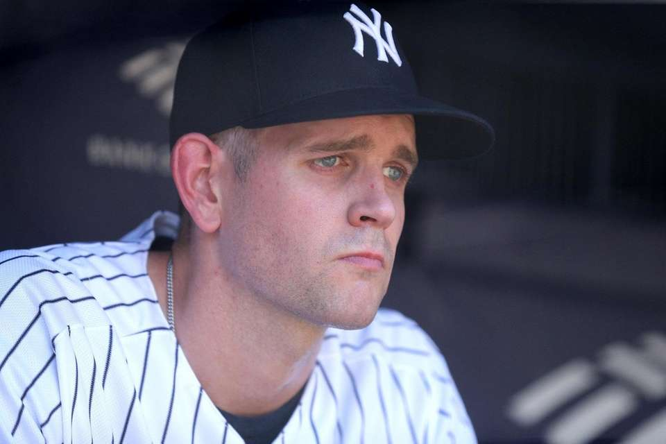 Yankees pitcher James Paxton reacts in the dugout