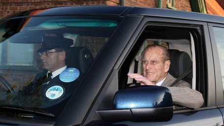 Britain's Prince Philip, right, is driven from Papworth